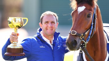 Charlie Appleby holds the Melbourne Cup as he poses alongside 2018 winner Cross Counter