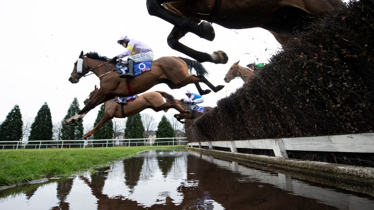 Takingrisks jumps the water on the way to victory in the Sky Bet Chase
