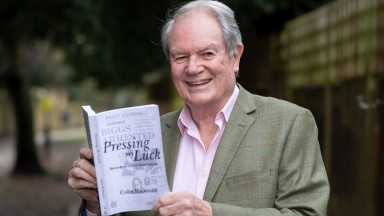 Former Racing Post writer Colin Mackenzie with a copy of his new memoir Pressing My Luck