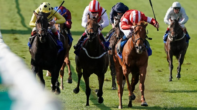 Daahyeh (red, right) wins the Rockfel Stakes at Newmarket