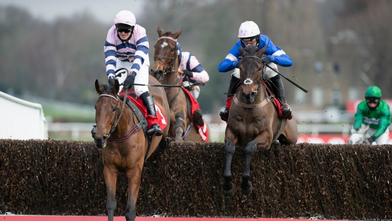 The winner Moonlighter (David Bass, left) jumps the last fence with Dolos (Harry Cobden) in the 2m handicap chaseSandown 6.2.21 Pic: Edward Whitaker/Racing Post