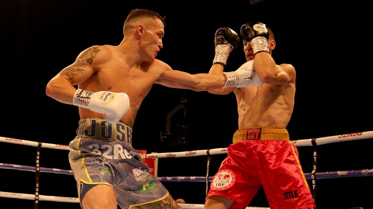 Josh Warrington (left) throws a punch at Sofiane Takoucht