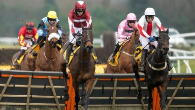 NEWBURY, ENGLAND - FEBRUARY 21: Jonjo O'Neill riding Soaring Glory (C, maroon) clear the last to win The Betfair Hurdle at Newbury Racecourse on February 21, 2021 in Newbury, England. Due to the coronavirus pandemic, owners along with the paying public wi