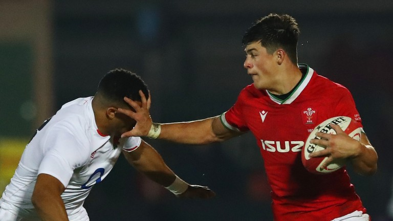 Wales winger Louis Rees-Zammit (right) has scored three tries in two matches