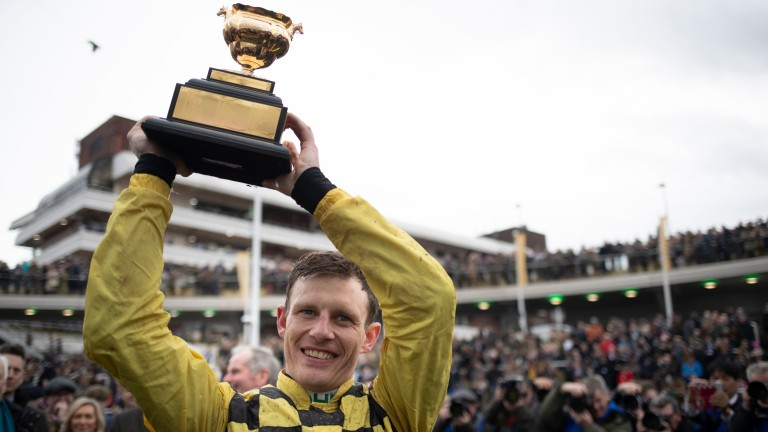 Paul Townend with his Cheltenham Gold Cup trophy after his 2019 win on Al Boum Photo