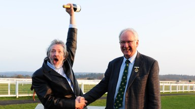 Drinks are on me: Steve Whiteley celebrates his Jackpot success as he receives a bottle of champagne from Exeter chairman Jeremy Colson