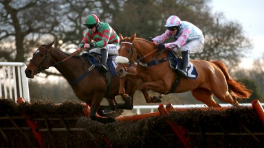 WETHERBY, ENGLAND - MARCH 08: Pay The Piper ridden by Danny McMenamin (L) clears a fence on their way to winning the Join Racing TV Now Handicap Hurdle on March 8, 2021 in Wetherby, England. (Photo by Tim Goode - Pool/Getty Images)
