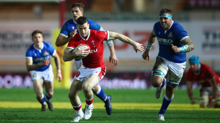 Wales scrum-half Gareth Davies breaks through to score a try against Italy in the Autumn Nations Cup