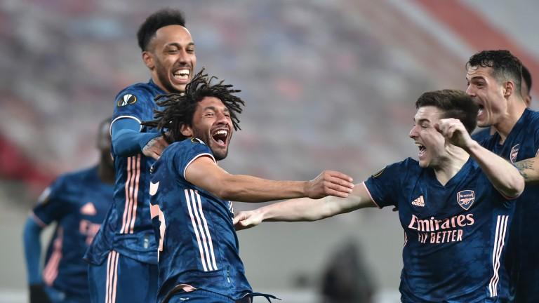 Mohamed Elneny celebrates his long-range strike in the first leg against Olympiakos