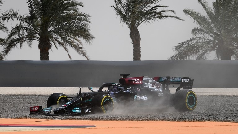 Lewis Hamilton's Mercedes gets stuck in the gravel on day two of pre-season testing in Bahrain