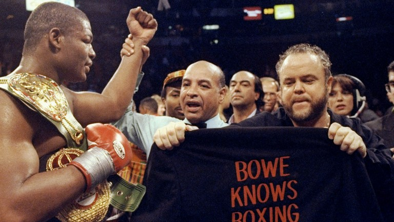 Riddick Bowe shows off the belt he won against Evander Holyfield in 1992, but weeks later that belt was in the bin