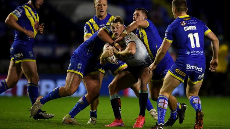 Warrington Wolves players swarm around Leeds's Jack Broadbend