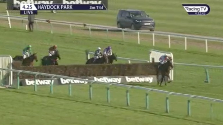 Back in the picture: Snuff Box (left) is motoring approaching the last fence and seemingly has a chance