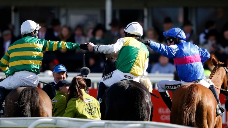 Leighton Aspell (centre) is congratulated by Tony McCoy (left) and Paul Moloney after winning the 2015 Grand National on Many Clouds
