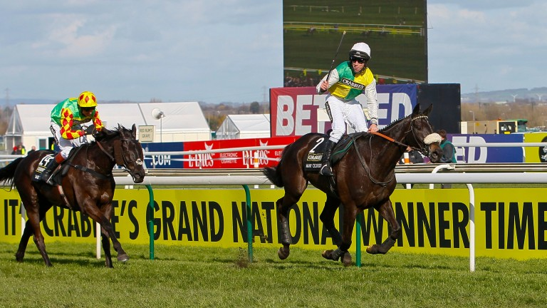 Leighton Aspell celebrates as Many Clouds beats Saint Are to win the 2015 Grand National at Aintree