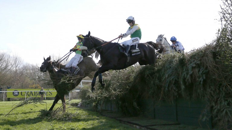 Many Clouds on his way to victory in the 2015 Grand National at Aintree