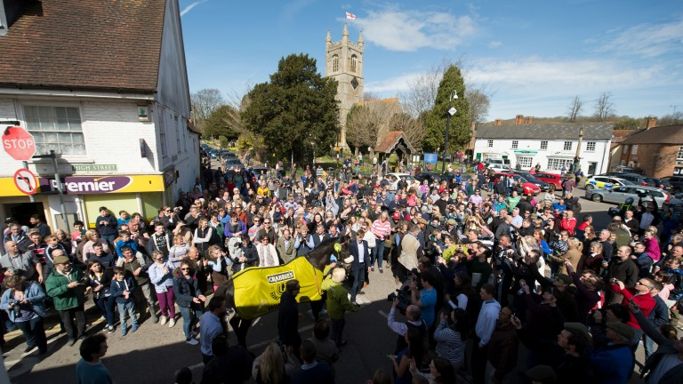 Many Clouds is greeted by hundreds of well wishers as he is led into the centre of Lambourn the day after winning the Grand National