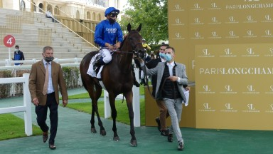 Philomeme and Mickael Barzalona return to the Longchamp winners' enclosure after winning on debut