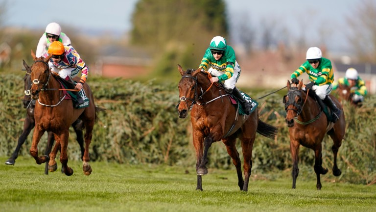 Minella Times (centre): led home an Irish domination in the Grand National
