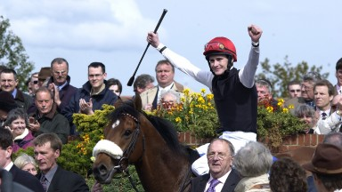 Refuse To Bend(Pat Smullen)are led into the winners enclosure after winning the 2,000 Guineas in 2003 PIC Ed Whitaker