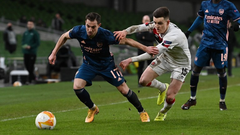 Dundalk's Darragh Leahy grappled with Arsenal's Cedric Soares in the Europa League