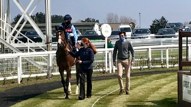 Coverham (Theodore Ladd) and winning trainer Harry Eustace come in after winning the opening mile handicap at Yarmouth