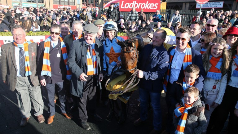The O'Connell family: easily recognisable at the races through their blue and orange scarves