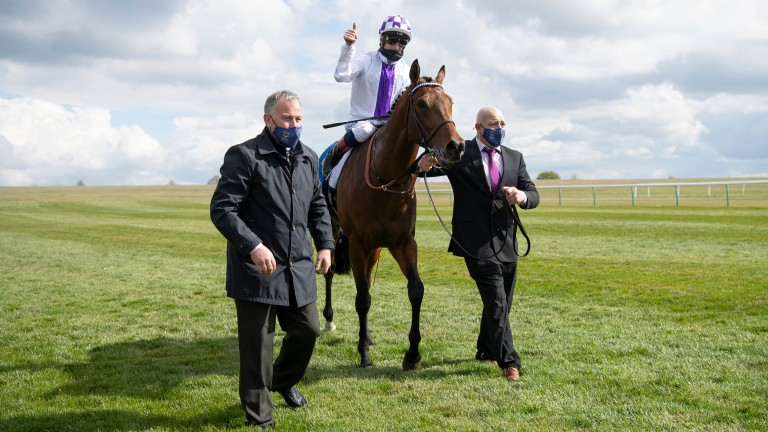 Poetic Flare and jockey Kevin Manning after victory in the 2,000 Guineas at Newmarket