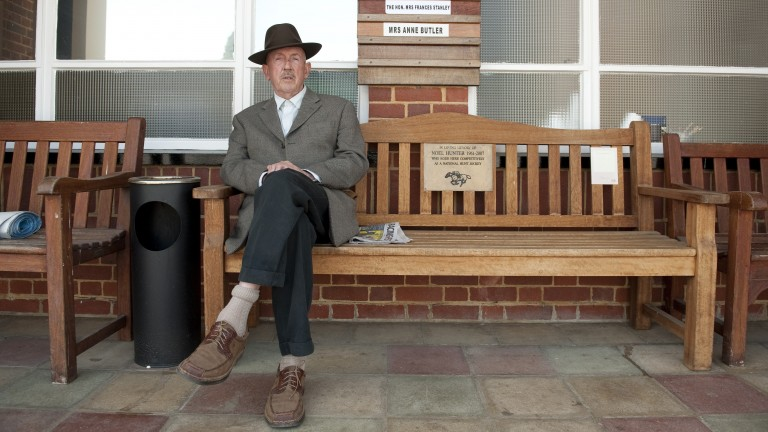 Barney Curley enjoys the shade outside the weighing room at Lingfield