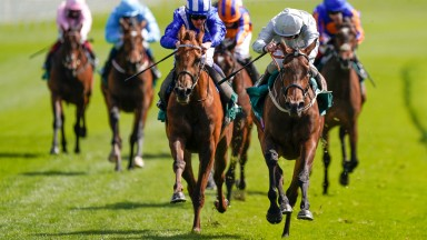 CHESTER, ENGLAND - MAY 05: Franny Norton riding Dubai Fountain (silver) win The Weatherbys ePassport Cheshire Oaks from Jim Crowly and Zeyaadah (blue) at Chester Racecourse on May 05, 2021 in Chester, England. Only owners are allowed to attend the meeting