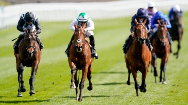 CHESTER, ENGLAND - MAY 05: Tom Marquand riding Youth Spirit (white) win The Chester Vase Stakes at Chester Racecourse on May 05, 2021 in Chester, England. Only owners are allowed to attend the meeting but the public must wait until further restrictions ar
