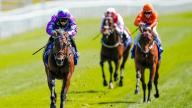 CHESTER, ENGLAND - MAY 05: Nicola Currie riding Navello (purple) win The ICM Stellar Sports Lily Agnes Conditions Stakes at Chester Racecourse on May 05, 2021 in Chester, England. Only owners are allowed to attend the meeting but the public must wait unti