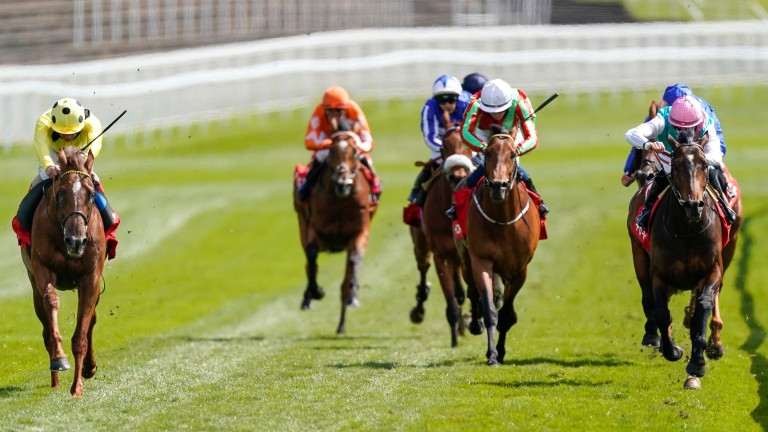 El Drama (left) puts in a good performance to win the Dee Stakes