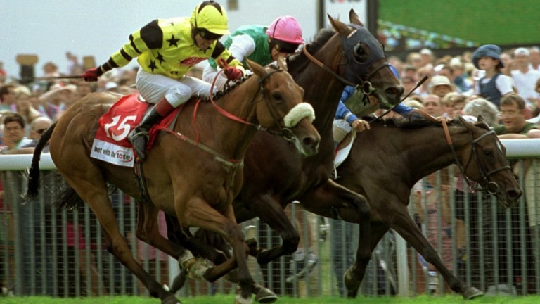 Tyrone Williams (yellow) judges things perfectly on Far Ahead in the Ebor in 1997
