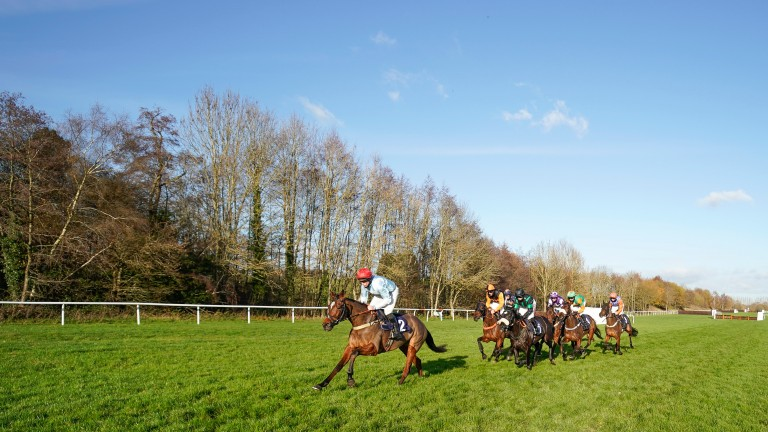 Anythingforlove (red cap) en route to landing her first GBB bonus at Lingfield