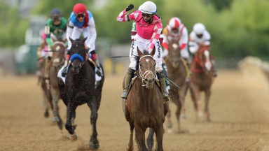 BALTIMORE, MARYLAND - MAY 15: Jockey Flavien Prat #6 riding Rombauer celebrates as he wins the 146th Running of the Preakness Stakes at Pimlico Race Course on May 15, 2021 in Baltimore, Maryland. (Photo by Patrick Smith/Getty Images) ***BESTPIX***