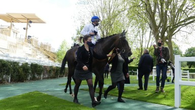 Coeursamba and Cristian Demuro return to the Longchamp winners' enclosure after winning The Emirates Poule d'Essai des Pouliches