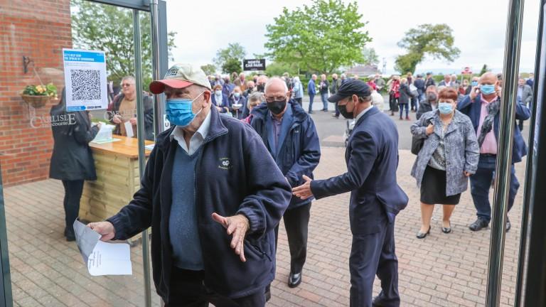Racegoers make their way through the entrance at Carlisle on Monday