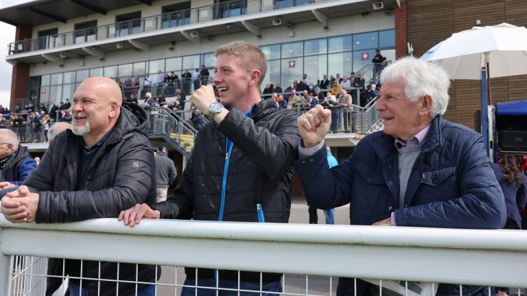 Punters celebrate a winner in the first race at Carlisle on Monday