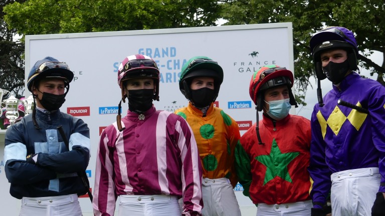 Rachael Blackmore (orange silks) and Danny Mullins (purple silks on right of picture) before the Grand Steeple-Chase de Paris