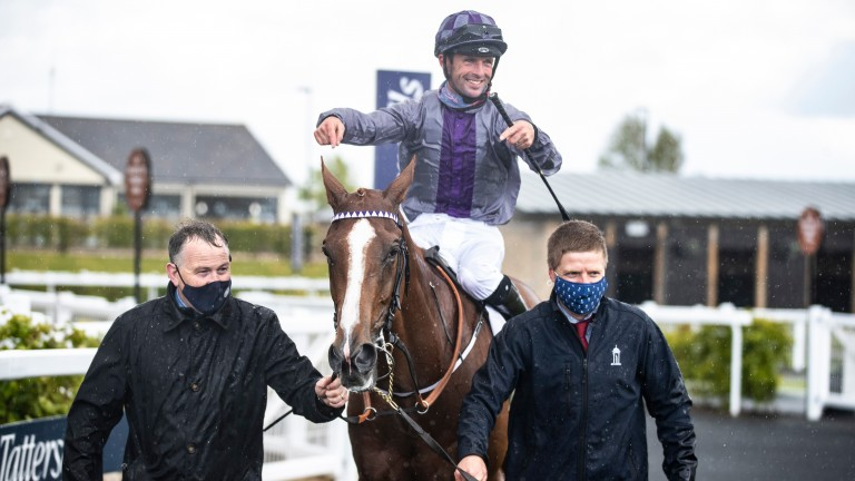 Jockey Rory Cleary points out the prowess of Mac Swiney after their victory in the Irish 2,000 Guineas