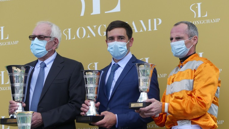 Jerome Reynier flanked by owner Jean-Claude Seroul and Gerald Mosse after Skalleti won the Prix d'Ispahan at Longchamp