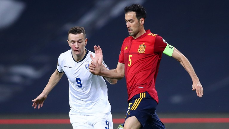 Deep-lying playmaker Sergio Busquets (right) is a key figure in Spain's midfield