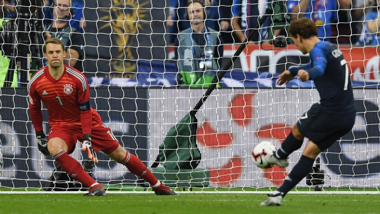 France's Antoine Griezmann sends Germany's Manuel Neuer the wrong way