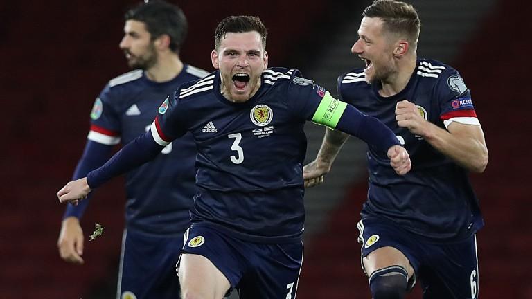 Andy Robertson celebrates Scotland's qualification