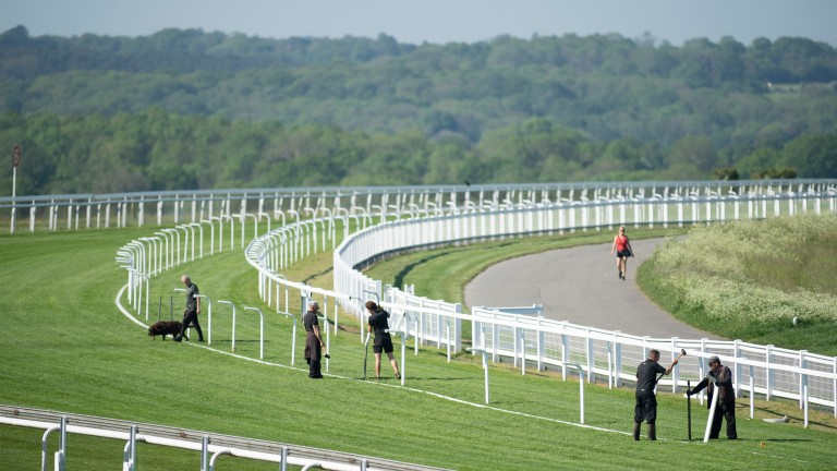 The temporary rail for Friday's Oaks card is put in place at Epsom this week
