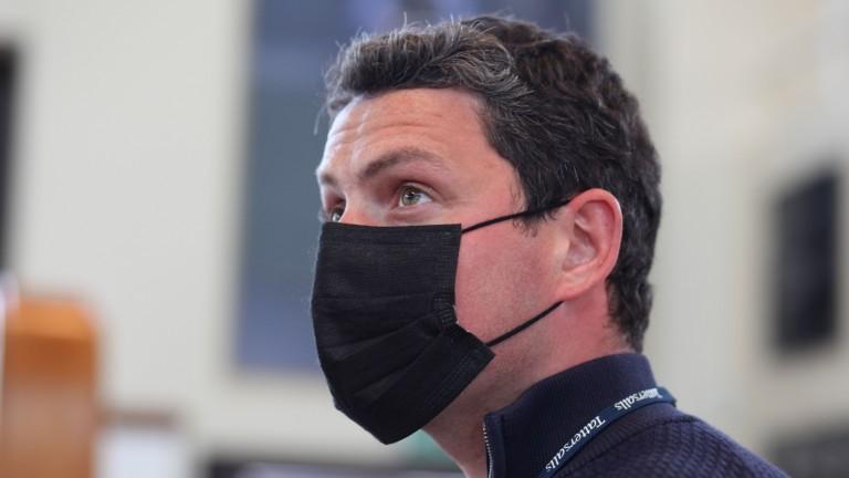Michael O'Callaghan keeps a close eye on the bid board