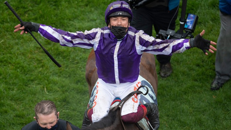 A delighted Frankie Dettori returns to the winner's enclosure at Epsom