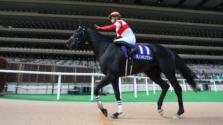 Danon Kingly receives a deserved pat from Yuga Kawada after winning the Yasuda Kinen at Tokyo