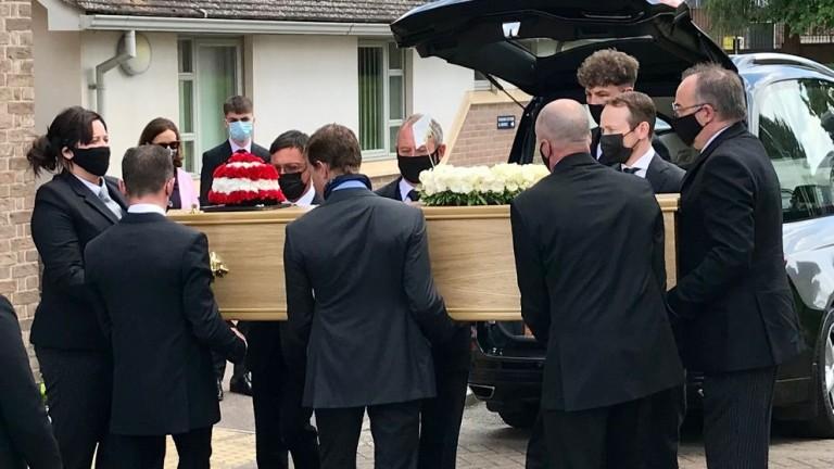Tom Queally, Frankie Dettori, Jamie Spencer, Shane Kelly, Andy Stringer and Glen Manchett  prepare to shoulder Barney Curley's coffin
